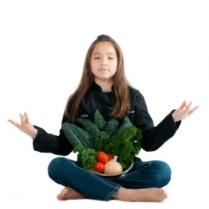 Kid chef Amber kelley with healthy vegetables