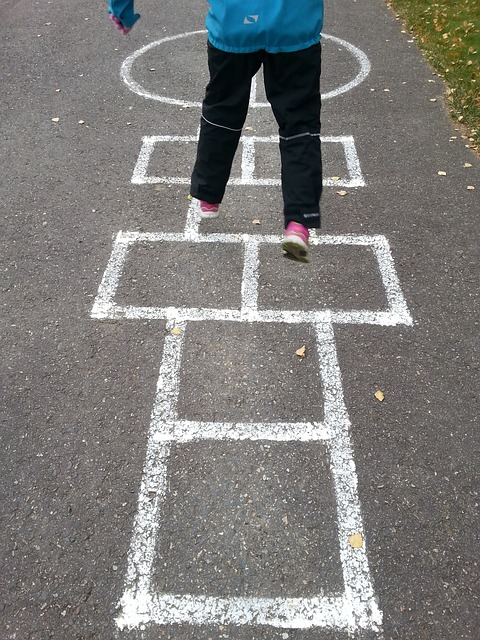 kid-hopscotch-playing-outside